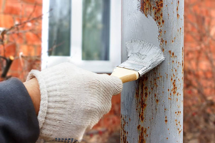how to apply primer for rusted metal