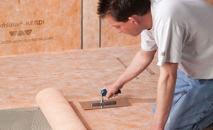 setting waterproofing membrane for showers